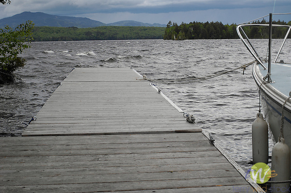 Stormy day at WildWay with sailboat at floating docks.