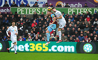 Burnley's Sam Vokes battles with Swansea City's Federico Fernandez<br /> <br /> Photographer Ashley Crowden/CameraSport<br /> <br /> The Premier League - Swansea City v Burnley - Saturday 10th February 2018 - Liberty Stadium - Swansea<br /> <br /> World Copyright &copy; 2018 CameraSport. All rights reserved. 43 Linden Ave. Countesthorpe. Leicester. England. LE8 5PG - Tel: +44 (0) 116 277 4147 - admin@camerasport.com - www.camerasport.com