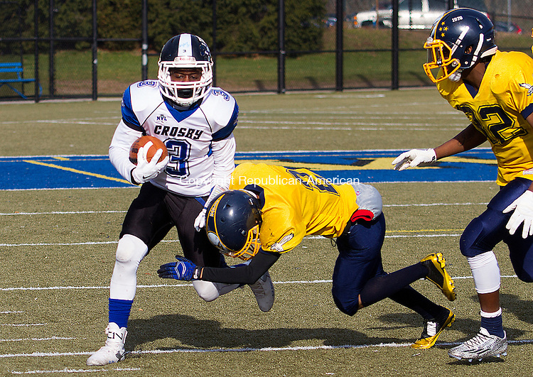 WATERURY, CT - 26 NOVEMBER 2015 -112615JW05.jpg -- Kennedy #2 Jedidiah Valdez chases out of bounds Crosby #3 Kenny Petteway during the Thanksgiving Day 2015 Brass Division and City Championship game at Ray Snyder Sr. Field Thursday morning. Crosby won 18-15.  Jonathan Wilcox Republican-American