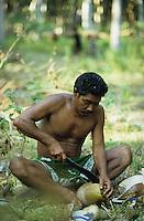 INDIEN Andamanen und Nikobaren, Insel Little Andaman, Dorf Harminder Bay der Nikobaresen wurde auch durch Tsunami zerstoert , die von der Insel Car Nicobar stammenden Nikobaresen wurden 1972 von der indischen Regierung auf Little Andaman angesiedelt, sie leben vom Anbai von Kokosnuessen / INDIA Andaman and Nicobar, Island Little Andaman, Nicobarese man in village Harminder Bay which was affected by Tsunami disaster, they cultivate coconut