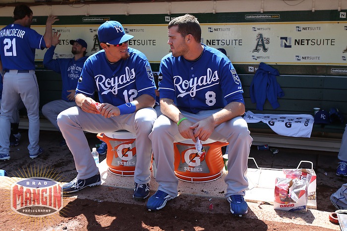 OAKLAND, CA - SEPTEMBER 5: Mitch Maier #12 and Mike Moustakas #8 of the Kansas City Royals sit on Gatorade buckets in the dugout before the game against the Oakland Athletics at O.co Coliseum on September 5, 2011 in Oakland, California. Photo by Brad Mangin