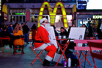 A man dressed as Santa Claus in seen in Times Square for holidays in New York, 12/9/2015 Photo by VIEWpress