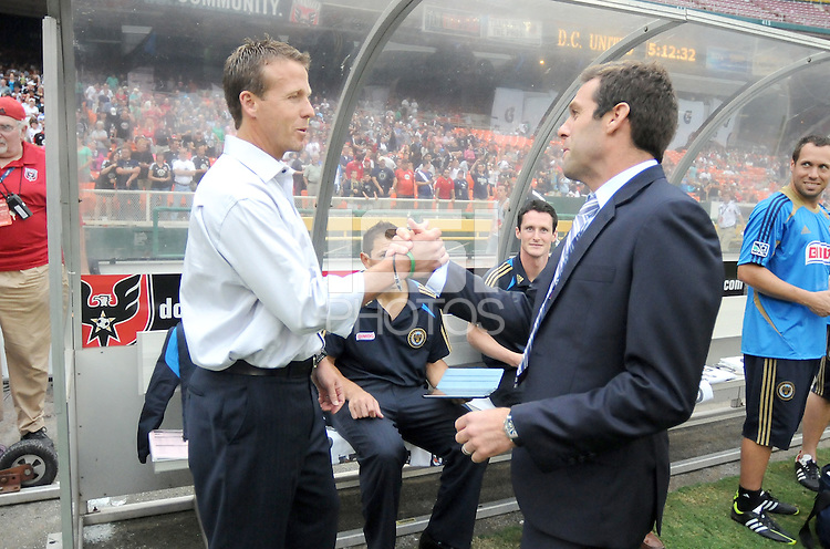 D.C. United head coach Ben Olsen greets Philadelphia Union head coach John Hackworth. D.C. United tied The Philadelphia Union 1-1 at RFK Stadium, Saturday August 19, 2012.