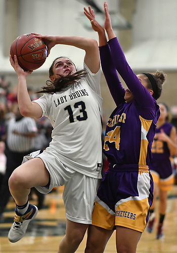 Jenna Annecchiarico #13 of Baldwin, left, drives to the net during the Class AA varsity girls basketball Long Island Championship against Central Islip at SUNY Old Westbury on Saturday, March 11, 2017. She tallied 12 points and seven steals as Baldwin, who led by one point (31-30) late in the third quarter, used a 22-0 run spanning the third and fourth quarters en route to a 56-31 win.