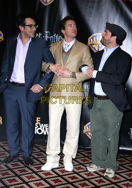 TODD PHILLIPS, ROBERT DOWNEY JR. & ZACH GALIFIANAKIS.Warner Brothers ShoWest Presentation at the Paris Resort Hotel and Casino, Las Vegas, Nevada, USA..March 18th, 2010.full length gold beige suit jacket white trousers cream grey gray jumper sweater blue suit purple shirt glasses profile looking up hat flat cap green arms linked  jeans denim.CAP/ADM/MJT.© MJT/AdMedia/Capital Pictures.