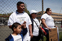 Newark, USA. 07th May 2014. Justin Ayala,his grandfather Antonio, grandmother maria and his mother Wendy arrive to a meeting asking for end to deportations of his father, outside a detention center office in New Jersey. Kena Betancur/VIEWpress