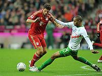 FUSSBALL   1. BUNDESLIGA  SAISON 2011/2012   15. Spieltag   03.12.2011 FC Bayern Muenchen - SV Werder Bremen        Mario Gomez (li, FC Bayern Muenchen) gegen Naldo (SV Werder Bremen)
