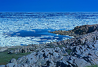 Ice on rocky shore Hudson Bay, Churchill, Manitoba, Canada