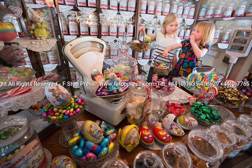 04/04/15<br /> <br /> Sisters, Maggie (7) and Martha (6) Ring, delight in choosing Easter eggs from Edward and Vintage, a traditional sweet shop in Tissington, in The Derbyshire Peak District.<br /> <br /> All Rights Reserved - F Stop Press.  www.fstoppress.com. Tel: +44 (0)1335 418629 +44(0)7765 242650