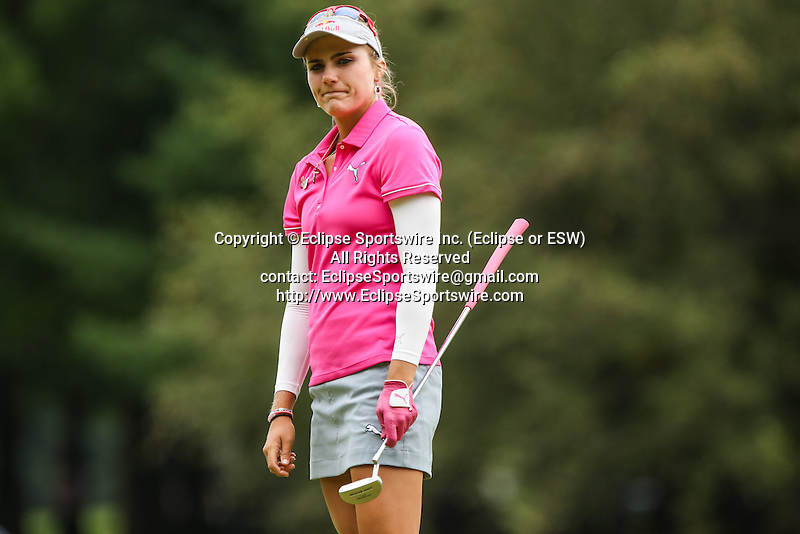 Lexi Thompson reacts after missing her putt on the 1st green at the LPGA Championship 2014 Sponsored By Wegmans at Monroe Golf Club in Pittsford, New York on August 16, 2014