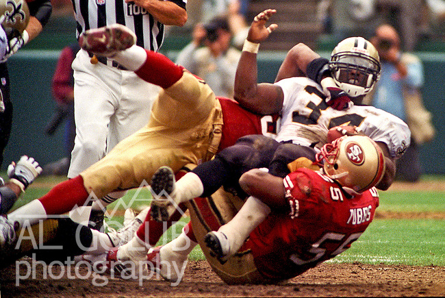 San Francisco 49ers vs. New Orleans Saints at Candlestick Park Sunday, September 19, 1999.  49ers beat Saints 28-21.  San Francisco 49ers linebacker Winfred Tubbs (55) tackles New Orleans Saints running back Ricky Williams (34).