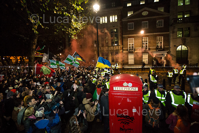 Great George Street - Move Back!<br /> <br /> London, 05/11/2015. Thousands of protesters gathered this evening in central London to take part in a demonstration called the &quot;Million Mask March&quot;, which is organised annually by Anonymous, and held globally in more than 400 cities planned to coincide with Guy Fawkes Night (The Gunpowder Plot of 1605). The aim of the demo was to highlight social injustice and Government corruption across the globe, but also to protect the environment, freedom of the internet, oppose mass surveillance and austerity. The rally started in Trafalgar Square, and then the protesters marched on Whitehall, gathering in Parliament Square. Around 7:00pm, a large group marched towards Great George street where clashes erupted with police officers in full riot gears, supported by police dogs and mounted police. Then, the demonstration carried on towards Victoria (where a police car was set on fire), Buckingham Palace and The Mall, to end in the Trafalgar Square area, where the police contained the last activists in &quot;kettles&quot; until around 11:30pm.<br /> <br /> For more information please click here: http://on.fb.me/1mcn5Z7
