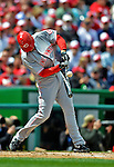 12 April 2012: Cincinnati Reds outfielder Ryan Ludwick breaks his bat as he makes contact against the Washington Nationals at Nationals Park in Washington, DC. The Nationals defeated the Reds 3-2 in 10 innings to take the first game of their 4-game series. Mandatory Credit: Ed Wolfstein Photo