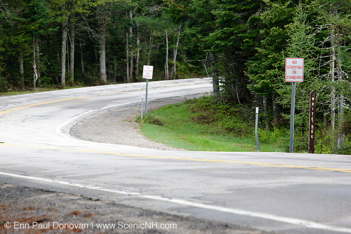 No Stopping or Standing sign on sharp corner along the Kancamagus Highway in the White Mountains, New Hampshire USA