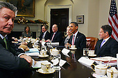 United States President Barack Obama (2nd R) hosts a meeting with U.S. Secretary of the Treasury Timothy Geithner (R), U.S. Secretary of State Hillary Rodham Clinton (3rd R) and European Union (EU) trade commissioner Karel Du Gucht (L) during a meeting at the White House on Monday, November 28, 2011 in Washington, DC. Obama hosted a meeting with member of the European Union delegation that is focused on the European debt crisis..Credit: Mark Wilson / Pool via CNP