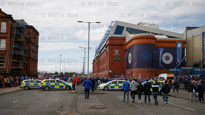Police cars used as a security blockade as hundreds of fans arrive at the stadium
