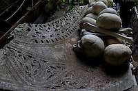 skulls on a carved coffin in a hidden cave in Toraja land, Sulawesi,  Indonesia