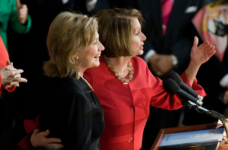 Secretary of State Hillary Clinton was on honored by Speaker Nancy Pelosi, D-Calif., right, and other members of Congress in Statuary Hall to during a reception to celebrate Women's History Month, March 25, 2010.