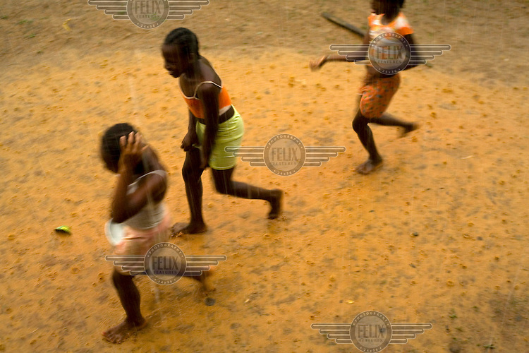 Girls run through the rain in San Miguel, an Afro Ecuadorian community located three hours up the Cayapas River in the province of Esmeraldas.