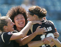 Tiffeny Milbrett (left) celebrates with Eriko Arakawa (center) and Christine Sinclair (right). FC Gold Pride defeated Washington Freedom 3-2 at Buck Shaw Stadium in Santa Clara, California on August 1, 2009.