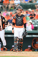 Baltimore Orioles catcher Caleb Joseph (63) during a spring training game against the Pittsburgh Pirates on March 23, 2014 at Ed Smith Stadium in Sarasota, Florida.  Baltimore and Pittsburgh tied 7-7.  (Mike Janes/Four Seam Images)