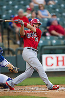 Memphis Redbirds third baseman Scott Moore #4 follows through on his swing during the Pacific Coast League baseball game against the Round Rock Express on April 24, 2014 at the Dell Diamond in Round Rock, Texas. The Express defeated the Redbirds 6-2. (Andrew Woolley/Four Seam Images)