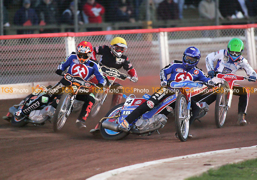 Arena Essex Hammers vs Reading Bulldogs - Elite League A - 28/04/06 - Heat 3 re-run - Leigh Lanham (blue) and Steve Johnston lead into the first corner ahead of Travis McGowan (green) and Chris Schramm - (Gavin Ellis 2006)