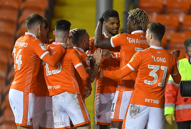 Blackpool's Michael Nottingham is congratulated on scoring his sides opening goal<br /> <br /> Photographer Dave Howarth/CameraSport<br /> <br /> The EFL Sky Bet League One - Blackpool v Doncaster Rovers - Tuesday 12th March 2019 - Bloomfield Road - Blackpool<br /> <br /> World Copyright © 2019 CameraSport. All rights reserved. 43 Linden Ave. Countesthorpe. Leicester. England. LE8 5PG - Tel: +44 (0) 116 277 4147 - admin@camerasport.com - www.camerasport.com