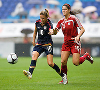 USWNT midfielder (10) Aly Wagner punts the ball forward past Canada's (15) Kara Lang during the finals of the Peace Queen Cup.  The USWNT defeated Canada, 1-0, at Suwon World Cup Stadium in Suwon, South Korea.