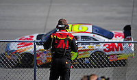 Sept. 19, 2008; Dover, DE, USA; A crew members looks on as Nascar Sprint Cup Series driver Greg Biffle drives past during practice for the Camping World RV 400 at Dover International Speedway. Mandatory Credit: Mark J. Rebilas-