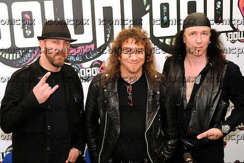 Anvil - L-R: former bassist Glenn Five, Steve 'Lips' Kudlow, Rob Reiner - photocall backstage on Day Two at the 2009 Download Festival, Donington Park, UK - 13 Jun 2009.  Photo by: George Chin/IconicPix