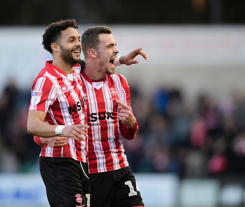Lincoln City's Bruno Andrade, left, celebrates scoring his side's second goal with team-mate Harry Toffolo<br /> <br /> Photographer Chris Vaughan/CameraSport<br /> <br /> The EFL Sky Bet League Two - Lincoln City v Stevenage - Saturday 16th February 2019 - Sincil Bank - Lincoln<br /> <br /> World Copyright © 2019 CameraSport. All rights reserved. 43 Linden Ave. Countesthorpe. Leicester. England. LE8 5PG - Tel: +44 (0) 116 277 4147 - admin@camerasport.com - www.camerasport.com