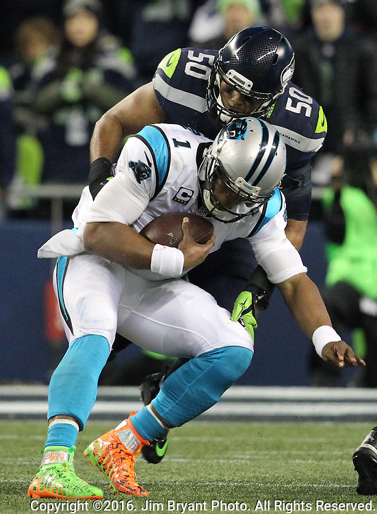 Carolina Panthers quarterback Cam Newton (1) is sacked for a two-yard loss by Seattle Seahawks outside linebacker K.J. Wright (50) at CenturyLink Field in Seattle, Washington on December 4, 2016.  Newton completed 14 of 32 passes for 182 yards and passed for one touchdown in the Panthers 7-40 loss to the Seahawks. ©2016. Jim Bryant photo. All Rights Reserved.