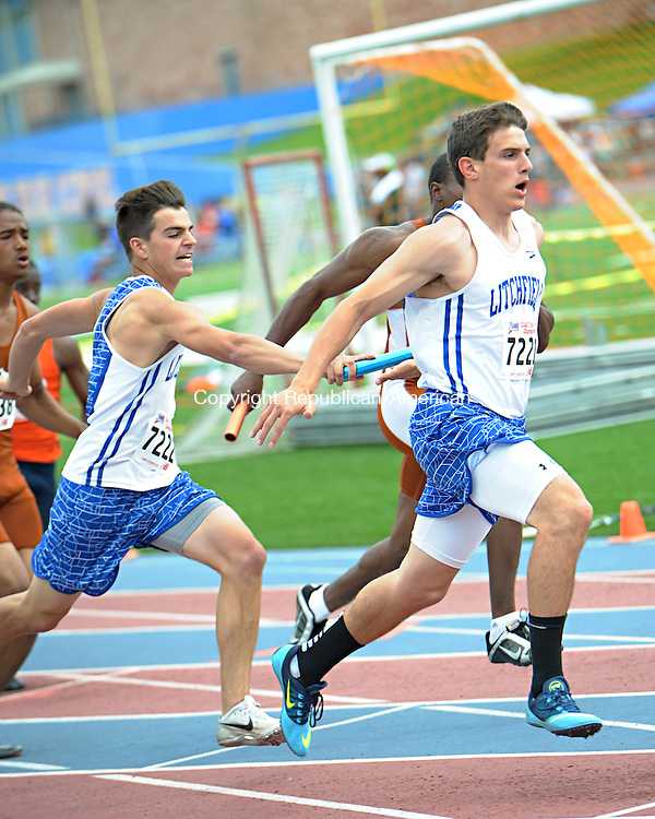 DANBURY, CT-4 June 2014-060414EC02-  Litchfield's Blaise Pope hands the baton to Spencer Persechino, starting the third section of the 4x100 meter relay. The Class S championships were held at Danbury High School Wednesday. Erin Covey Republican-American