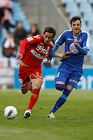 07.04.2012 SPAIN -  La Liga matchday 32th  match played between Getafe vs Sporting at Coliseum Alfonso Perez stadium (2-0). Picture show Oscar Guido Trejo and  Miguel Marcos Madera (Midfielder of Getafe)