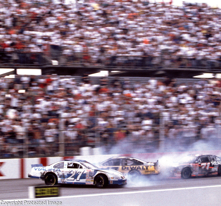 Mike Bliss(#27) , Matt Kenseth and Dave Marcis (#71) crash on the frontstretch at Darlington, SC during the Pepsi Southern 500 NASCAR race on Sunday, 9/3/00.(Photo by Brian Cleary)