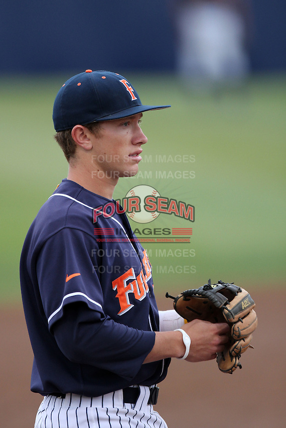 Blake Barber #13 of the Cal. St. Fullerton Titans during game against the Cal. St. Long Beach 49'ers at Goodwin Field in Fullerton,California on May 14, 2011. Photo by Larry Goren/Four Seam Images