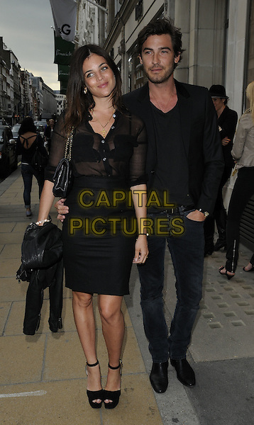JULIA  RESTOIN-ROITFELD & ROBERT  KONJIC.The Emporio Armani Summer Garden Live Final Series Of Music Events at the Emporio Armani boutique in New Bond St., London, England..July 14th, 2011.full length black skirt sheer blouse top see through thru bra arm around waist shirt jeans denim couple ankle strap shoes peep toe.CAP/CAN.©Can Nguyen/Capital Pictures.