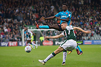 Jordy Hiwula of Fleetwood Town attempts to charge down the clearance of Aaron Taylor-Sinclair of Plymouth Argyle during the Sky Bet League 1 match between Plymouth Argyle and Fleetwood Town at Home Park, Plymouth, England on 7 October 2017. Photo by Mark  Hawkins / PRiME Media Images.