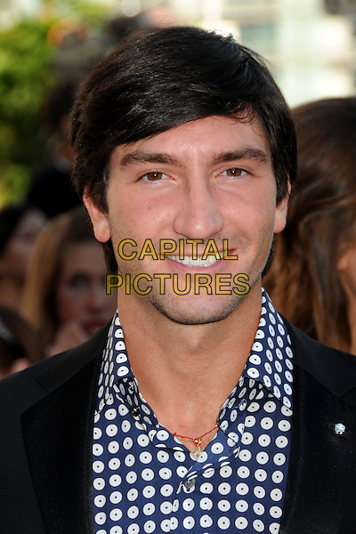 "EVAN LYSACEK.""The Twilight Saga: Eclipse"" Los Angeles Premiere at the 2010 Los Angeles Film Festival held at Nokia Theatre LA Live, Los Angeles, California, USA, 24th June 2010..portrait headshot smiling  blue white print  .CAP/ADM/BP.©Byron Purvis/AdMedia/Capital Pictures."