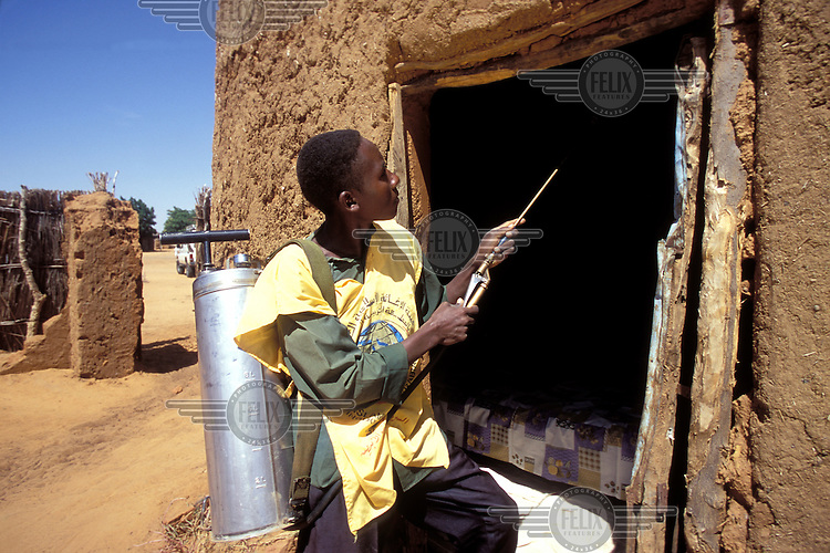 © Giacomo Pirozzi / Panos Pictures..Kordofan, SUDAN..Spraying homes against malaria.