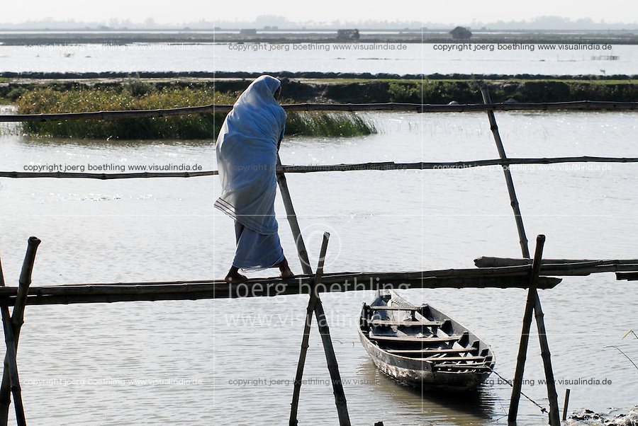 "Asien Suedasien Bangladesh , Bruecke aus Bambus ueber einen Shrimps Teich , Shrimpsfarmen versalzen die Boeden und machen das Land fuer den Reisanbau unfruchtbar   -  Landwirtschaft xagndaz | .South asia Bangladesh , bamboo bridge across a shrimps pond with saline water in coastal belt of Bengal .| [ copyright (c) Joerg Boethling / agenda , Veroeffentlichung nur gegen Honorar und Belegexemplar an / publication only with royalties and copy to:  agenda PG   Rothestr. 66   Germany D-22765 Hamburg   ph. ++49 40 391 907 14   e-mail: boethling@agenda-fototext.de   www.agenda-fototext.de   Bank: Hamburger Sparkasse  BLZ 200 505 50  Kto. 1281 120 178   IBAN: DE96 2005 0550 1281 1201 78   BIC: ""HASPDEHH"" ,  WEITERE MOTIVE ZU DIESEM THEMA SIND VORHANDEN!! MORE PICTURES ON THIS SUBJECT AVAILABLE!!  ] [#0,26,121#]"