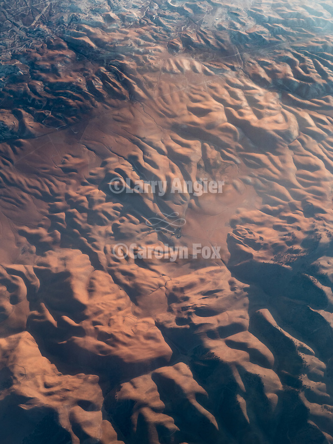 Rugged landscape between the Central Valley and LA, California from a window seat–America's flyover country: SMF-LAX-MDW