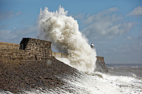 2019 04 27 Waves crash against the lighthouse in Porthcawl, Wales, UK