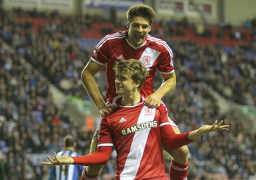 Middlesbrough's Patrick Bamford celebrates scoring his sides first goal  with George Friend<br /> <br /> Photographer Mick Walker/CameraSport<br /> <br /> Football - The Football League Sky Bet Championship - Wigan Athletic v Middlesbrough - Saturday 22nd November 2014 - DW Stadium - Wigan<br /> <br /> &copy; CameraSport - 43 Linden Ave. Countesthorpe. Leicester. England. LE8 5PG - Tel: +44 (0) 116 277 4147 - admin@camerasport.com - www.camerasport.com
