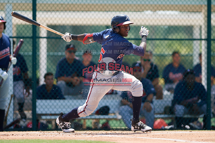 GCL Braves third baseman Jean Carlos Encarnacion (25) follows through on a swing during a game against the GCL Pirates on July 26, 2017 at Pirate City in Bradenton, Florida.  GCL Braves defeated the GCL Pirates 12-5.  (Mike Janes/Four Seam Images)