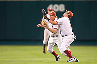 Oklahoma's 2B Danny Black collides with RF Cody Reine in Game 3 of the NCAA Division One Men's College World Series on Sunday June 20th, 2010 at Johnny Rosenblatt Stadium in Omaha, Nebraska.  (Photo by Andrew Woolley / Four Seam Images)