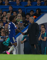 Chelsea Manager José Mourinho hakes hands with goal scorer Willian of Chelsea as he comes off during the UEFA Champions League match between Chelsea and Maccabi Tel Aviv at Stamford Bridge, London, England on 16 September 2015. Photo by Andy Rowland.