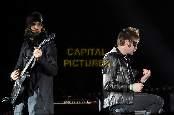 Sergio Pizzorno and Tom Meighan of Kasabian.performing live at Reading Festival, Reading, England, UK, .25th August 2012..music on stage live in concert gig half length black leather jacket playing guitar .CAP/MAR.© Martin Harris/Capital Pictures.