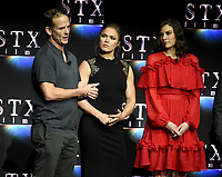 LAS VEGAS, NV - APRIL 24: (L-R) Director Peter Berg, actors Ronda Rousey, Lauren Cohan onstage during the STX Films presentation at CinemaCon 2018 at The Colosseum at Caesars Palace on April 24, 2018 in Las Vegas, Nevada. (Photo by Frank Micelotta/PictureGroup)